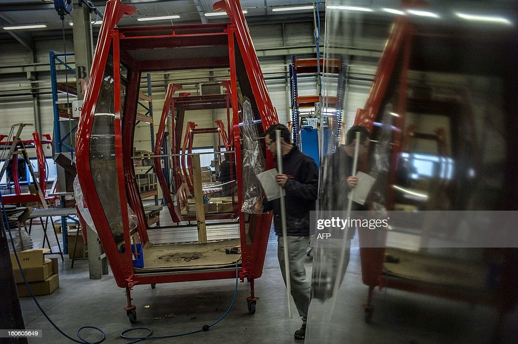 An employee of Poma's subsidiary Sigma works on a cabin lift, on January 16, 2013 in Veyrins-Thuellin, French Alps. AFP PHOTO / JEFF PACHOUD