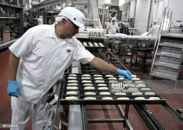 An employee of Rich Products checks bread dough for dinner rolls before it's baked on September 21 2005 in Fort Erie Ontario Rich Products started in...