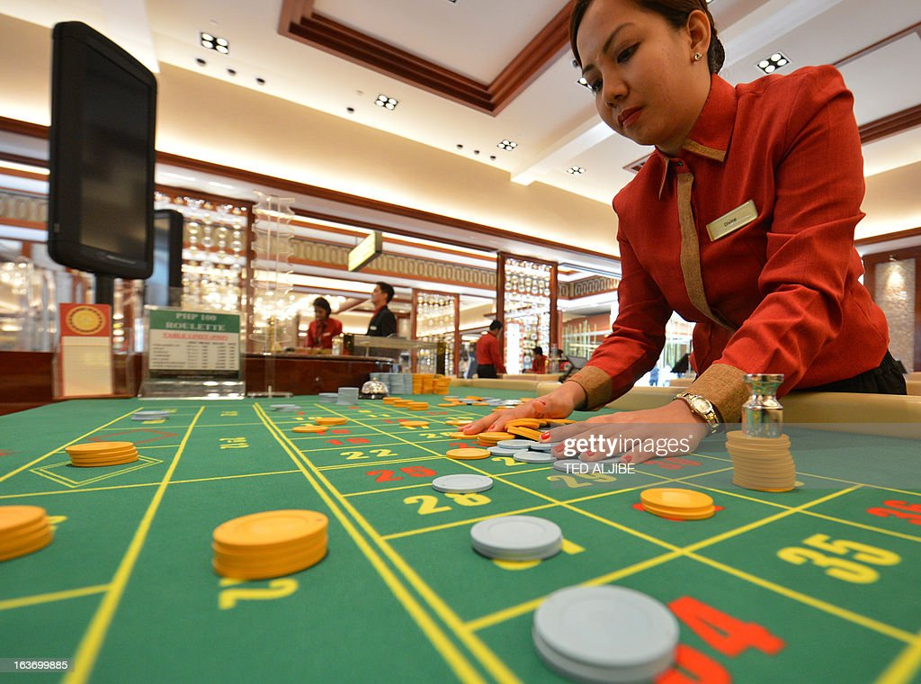 An employee of Solaire Manila Resorts and casino checks chips during media day inside the casino in Manila on March 14, 2013, ahead of its opening on March 16. The Philippines makes its biggest bet this weekend in a high-stakes bid to join the world's elite gaming destinations, with the launch of a $1.2-billion casino on Manila Bay.Solaire Manila Resorts is the first of four enormous entertainment venues slated to rise over a giant chunk of prime, reclaimed land that industry and government leaders expect will attract millions of cashed-up Asian tourists.