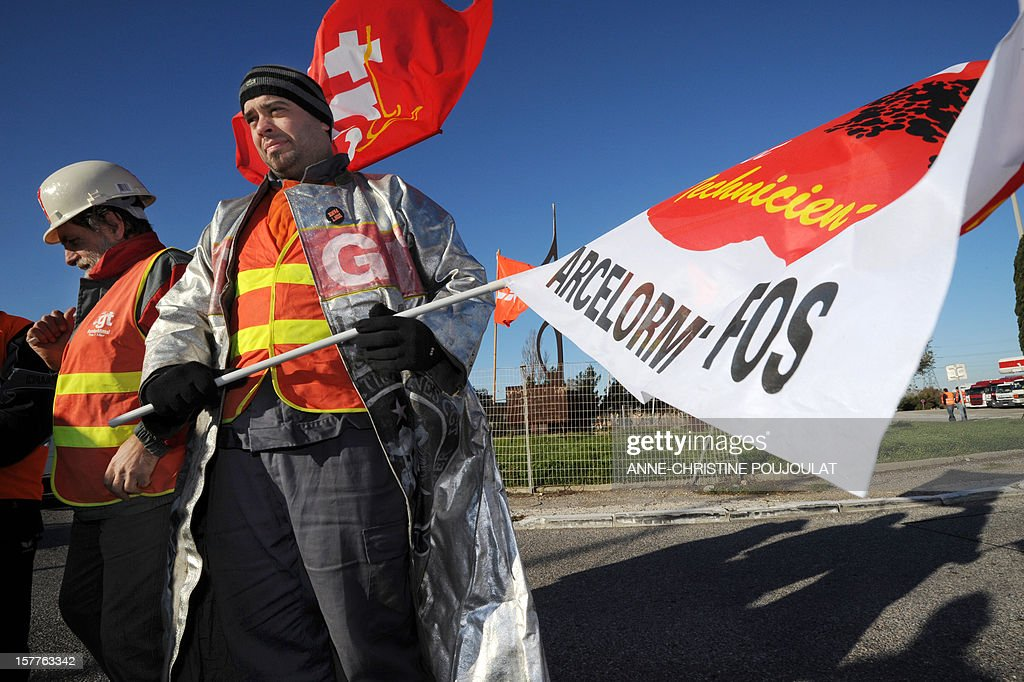 An employee of the ArcelorMittal plant of Fos-sur-Mer take part in the site blockade, on December 6, 2012 in Fos-sur-Mer, in support of employees of the group's plant in Florange, eastern France. French local newspaper Le Republicain Lorrain and other medias revealed that either Russian Severstal or Belgian CMI steel groups were reportedly the investors ready and willing to put 400 million euros ($515 million) into the Florange steel plant, at the centre of a dispute between the owner ArcelorMittal and the government.