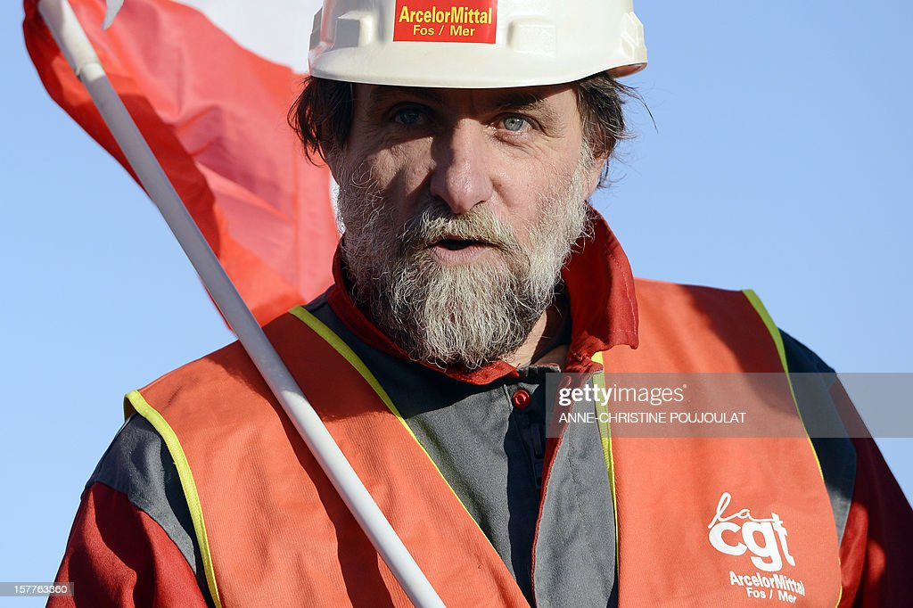 An employee of the ArcelorMittal plant of Fos-sur-Mer takes part in the site blockade, on December 6, 2012 in Fos-sur-Mer, in support of employees of the group's plant in Florange, eastern France. French local newspaper Le Republicain Lorrain and other medias revealed that either Russian Severstal or Belgian CMI steel groups were reportedly the investors ready and willing to put 400 million euros ($515 million) into the Florange steel plant, at the centre of a dispute between the owner ArcelorMittal and the government.