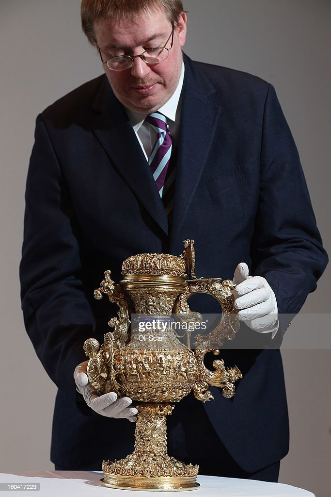 An employee of the Ashmolean Museum moves a 'silver gilt ewer with enamelled royal arms of Portugal' that dates from around 1510 AD, prior to an announcement of a major bequest of silver artifacts on January 31, 2013 in London, England. The Ashmolean has received a major collection of around 500 silver objects from the Renaissance and Baroque periods from the late silver merchant and expert Michael Wellby who died last year.