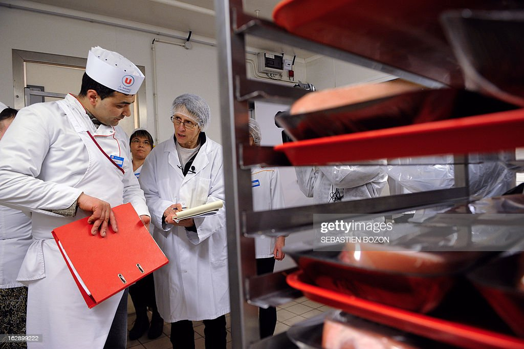 An employee (2ndL) of the DDCSPP (Departmental Directorate of Social Cohesion and Protection of Populations) conducts a verification of the origine of the meat in a supermarket in Besançon, eastern France, on March 1, 2013. An Europe-wide food fraud scandal over horsemeat sold as beef emerged in mid-January when Irish authorities found traces of horse in beefburgers made by firms in Ireland and Britain and sold in supermarket chains including Tesco and Aldi. The scandal intensified earlier this month when Comigel -- a French frozen meal maker which bought 500 tonnes of mislabelled horsemeat from Spanghero -- alerted Findus to the presence of horsemeat in the meals it had made for the food giant and which were on sale in Britain. AFP PHOTO / SEBASTIEN BOZON