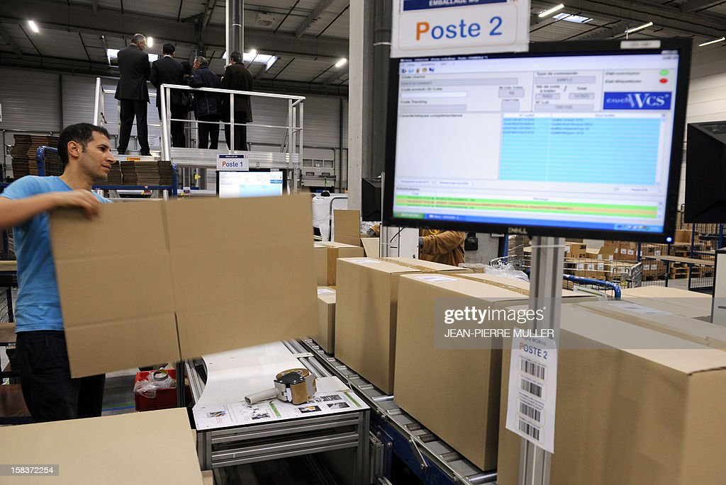 An employee of the French 'C Discount' online trade company prepares to package items in a store in Cestas, southwestern France, on December 14, 2012.
