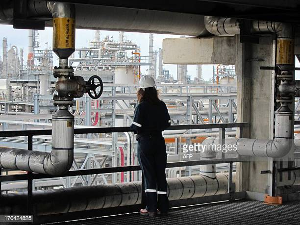 An employee of the French oil giant Total gathers informations on the company's Texan plant in Port Arthur on June 6 2013 AFP PHOTO / MARC PREEL