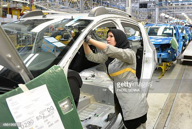 An employee of the French Renault group in Morocco works on a production line at the Renault factory of Melloussa near Tangier on April 23 2014 AFP...