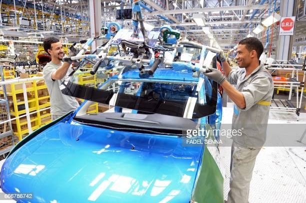 An employee of the French Renault group in Morocco works on a production line at the Renault factory of Melloussa near Tangier on April 23 2014 / AFP...