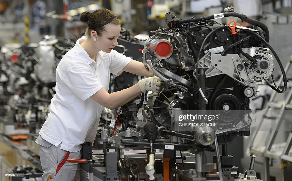 An employee of the German car maker Audi works in the engine assembly section of the car factory in Ingolstadt, southern Germany, on March 11, 2013. Audi presents further details on the company results 2012 at the Audi Annual Press Conference on March 12, 2013 in Ingolstadt.