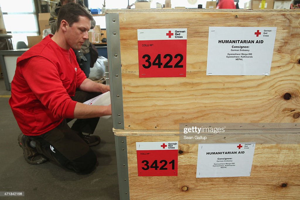 An employee of the German Red Cross prepares a shipment destined for German Embassy personnel in Kathmandu in the organization's warehouse for...
