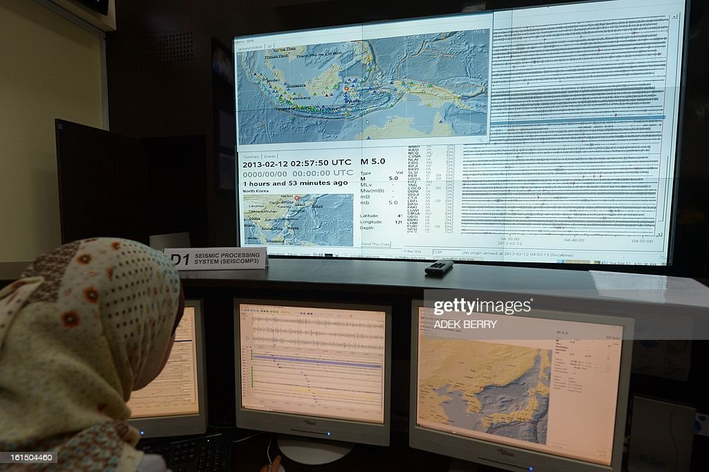 An employee of the Indonesian Meteorology, Geophysics and Climatology Agency (BMKG) operate screens that show seismic activity after a North Korean nuclear test (at 2:57:50 UTC), in Jakarta on February 12, 2013. North Korea confirmed it had 'successfully' carried out an underground nuclear test, drawing immediate condemnation from rival South Korea.