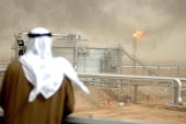 An employee of the Kuwait Oil Company looks at 25 January 2005 the Gathering Center No15 of alRawdatain field 100 kms north of Kuwait City following...