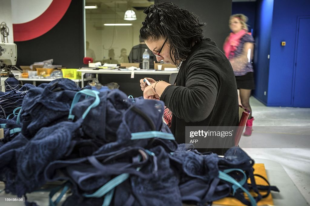 An employee of the new lingerie company 'Les Atelieres' works in Villeurbanne, centraleastern France, on January 14, 2013. 'Les Atelieres' was founded after the recent decline of the lingerie company Lejaby and employs six former workers of Lejaby, amongst its 26 employees. It launched production today.