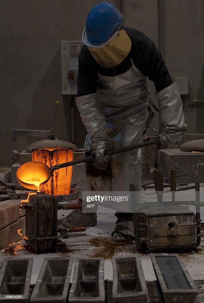 An employee of the Noack foundry pours melted silicon bronze into a mould to cast the Golden Bear trophy for the upcoming Berlinale Film Festival in Berlin, Germany on January 23, 2013. The prestigious trophy has been crafted by the Noack Fine Art Foundry, family enterprise, since 1951. The Berlinale is the first major European film festival of the year 2013, running from February 7 to 17. AFP PHOTO / BARBARA SAX