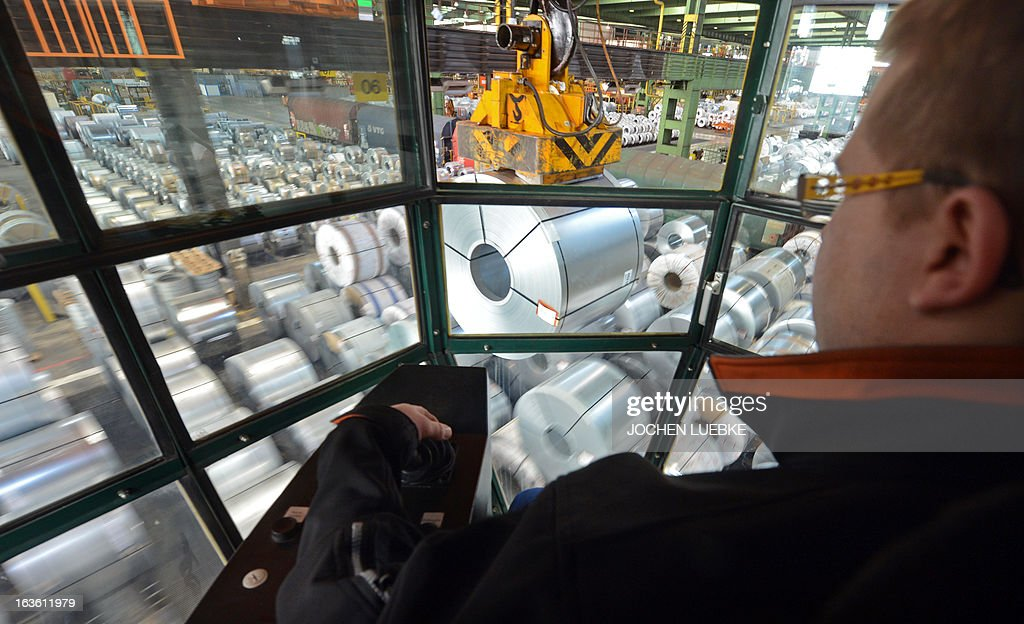 An employee of the Salzgitter AG sits in a crane and maneuvers coils at the company's plant in Salzgitter, central Germany, on March 13, 2013. Salzgitter AG is Germany's number-two steel maker.