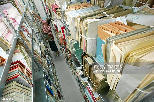 An employee of the Stasiarchives searches for documents in the files department 08 July 2003 in Berlin Files compiled by the former East German state...