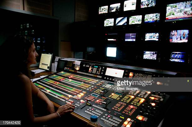 An employee of the state broadcaster ERT works in the control room during an online news bulletin broadcast at the corporation's headquarters during...