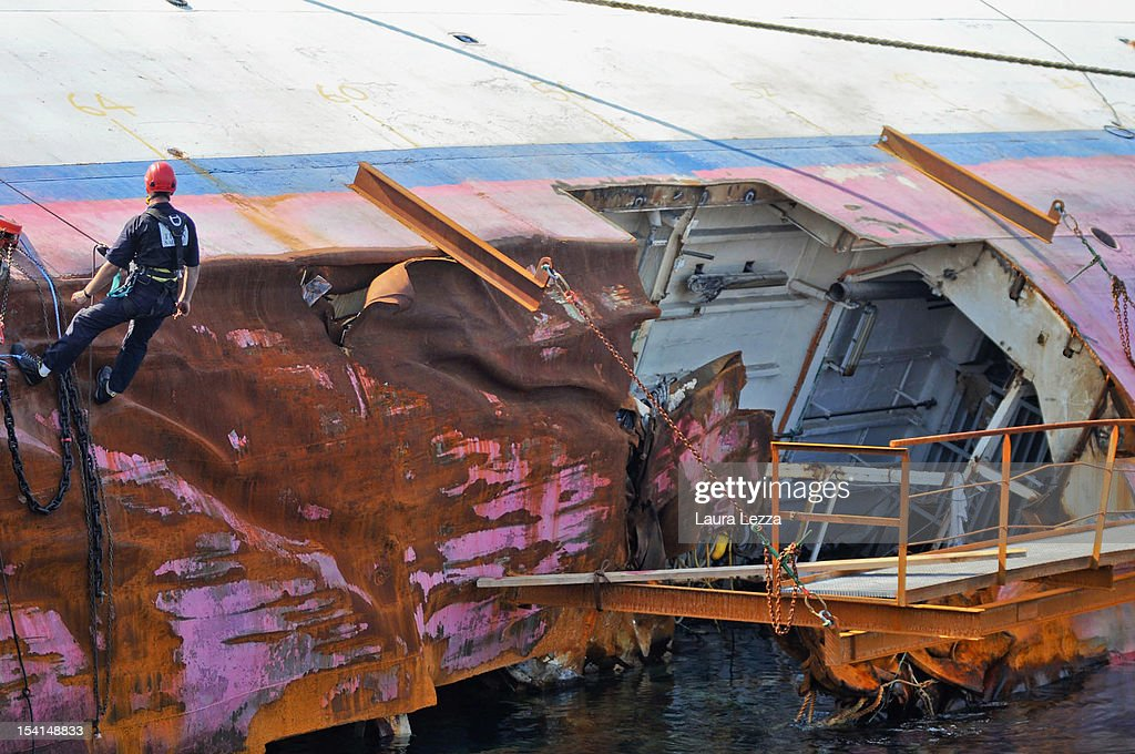 An employee of Titan-Micoperi are seen near the hull breach of Costa Concordia, which is the subject of the investigations of the Codacons experts on July 25, 2012 in Giglio Porto, Italy. The College expert Codacons is a group of university professors and experts engaged in the work of data analysis of the black box and procedural documents relating to the investigation of the sinking of the Costa Concordia cruise liner. A preliminary court hearing into the incident starts on October 15, 2012 in Grosseto, Italy, during which experts will present their findings.