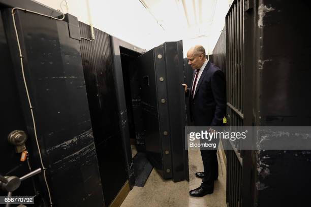 An employee opens a disused security vault door previously used to store diamonds at the De Beers SA headquarters on Charterhouse Street in London UK...