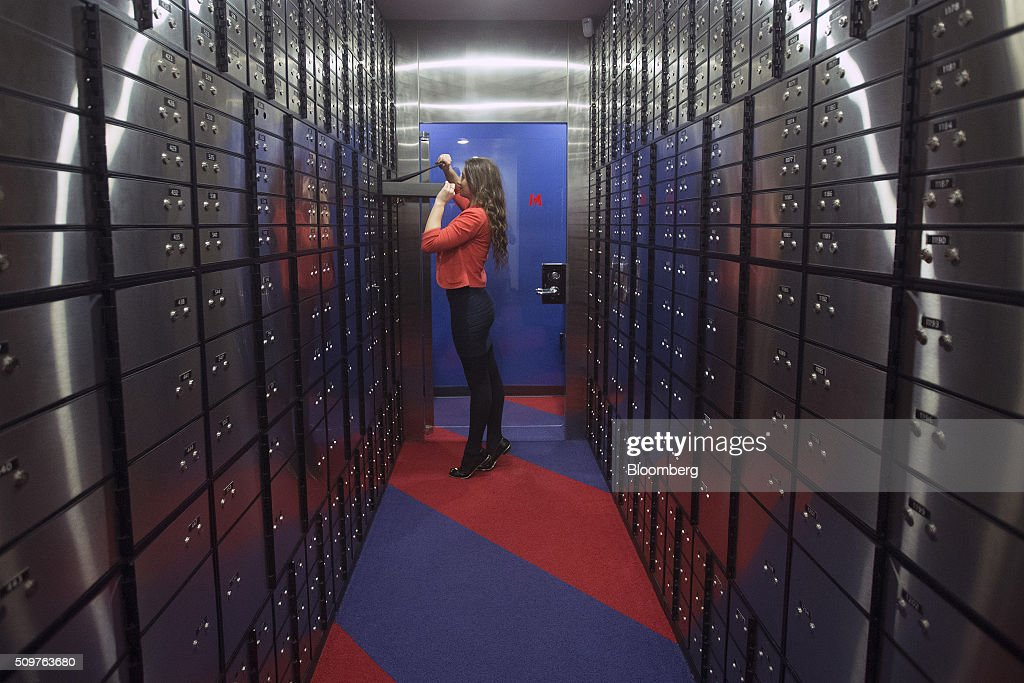 An employee opens a safety deposit box in this arranged photograph inside a branch of Metro Bank Plc in London, U.K., on Friday, Feb. 12, 2016. Metro Bank, the British lender backed by wealthy American financiers including Steven Cohen, plans to sell shares to existing investors before going public on the London Stock Exchange. Photographer: Simon Dawson/Bloomberg via Getty Images