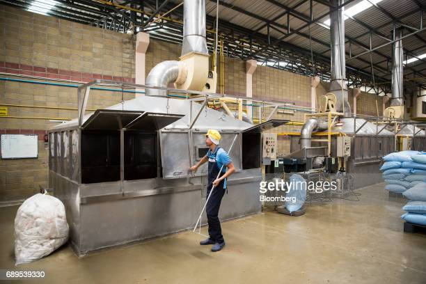 An employee opens the doors of a dehydrating machine at the Nithi Foods Co factory in the San Pa Tong district of Chiang Mai Thailand on Tuesday May...