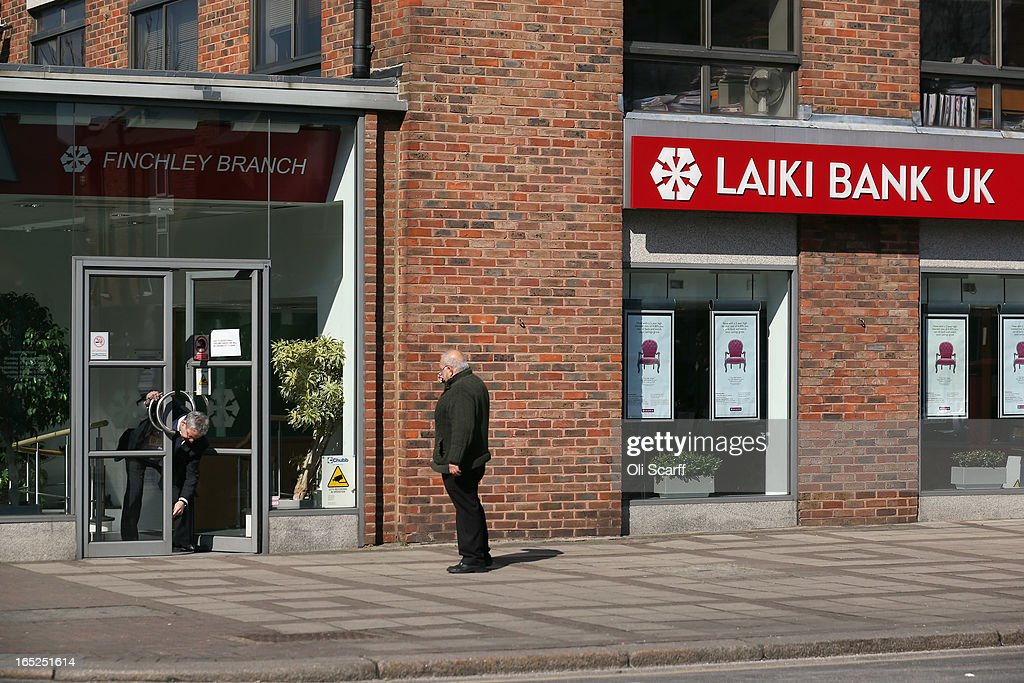 An employee opens the doors to a branch of Laiki Bank UK, a subsiduary of Cyprus Popular Bank, on April 2, 2013 in London, England. Customers with funds in Laiki Bank UK will not face a levy on their accounts, which is being imposed in Cyprus on deposits of over 100,000 Euros as part of the European Union's bail-out package for the Cypriot economy. The Bank of England's Prudential Regulation Authority has announced that all deposits in Laiki Bank UK will be automatically transferred to Bank of Cyprus in the UK.