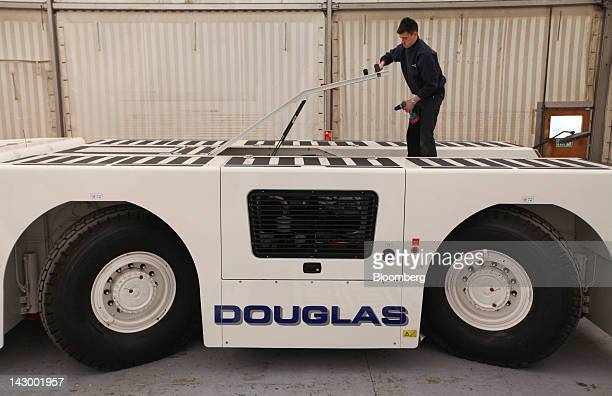 An employee opens the engine hatch on an aviation towing tractor at the Douglas Equipment plant owned by CurtissWright Corp in Cheltenham UK on...