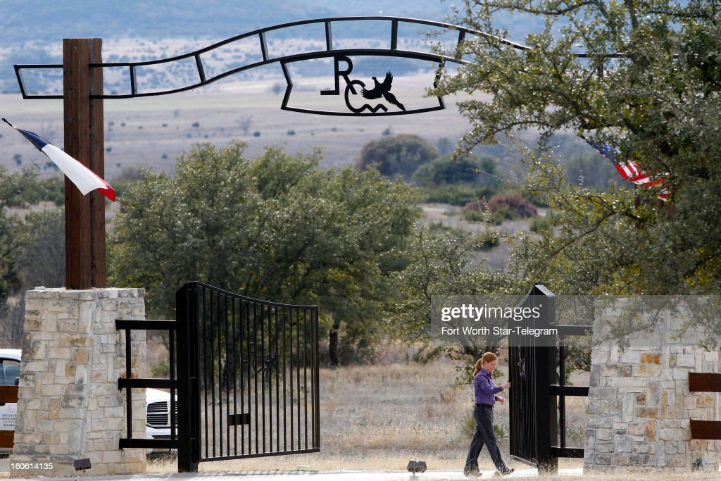 An employee opens the gate to let out cars at the entrance Rough Creek Lodge in Glen Rose, Texas, Sunday, February 3, 2013. Chris Kyle and Chad Littlefield were found murdered at the gun range on the property.