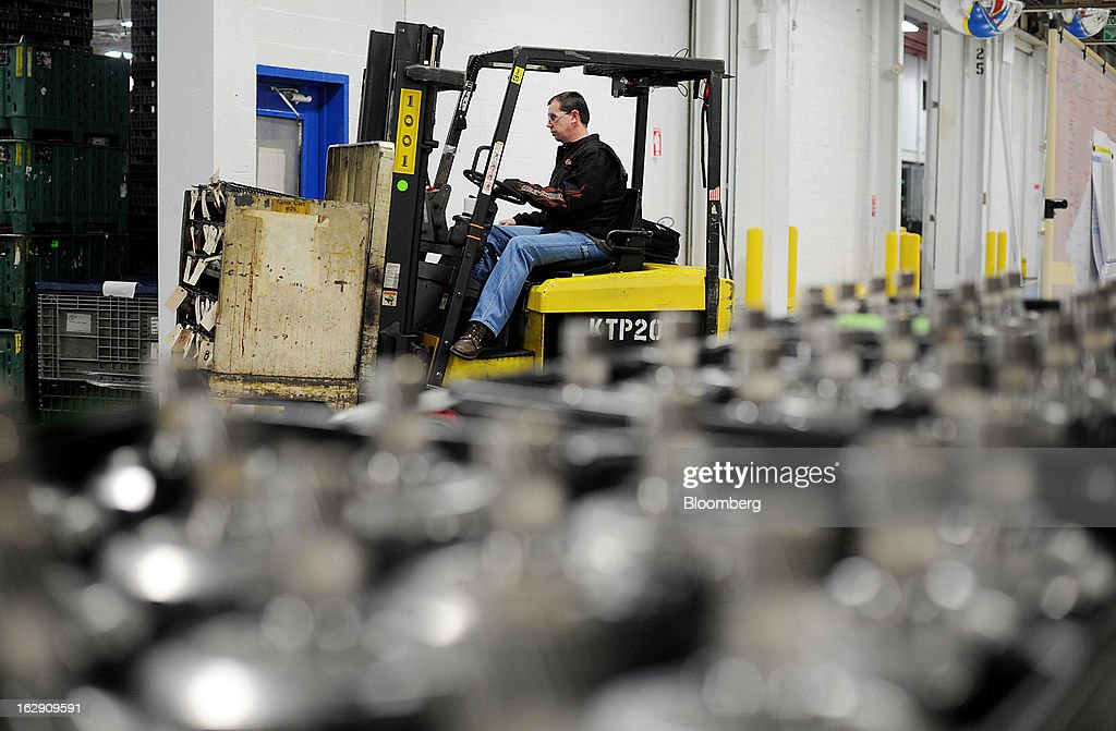 An employee operates a a fork lift at the Chrysler Group transmission plant in Kokomo, Indiana, U.S., on Thursday, Feb. 28, 2013. Chrysler Group LLC, the automaker majority owned by Fiat SpA, will invest about $374 million and add 1,250 jobs at Indiana factories to boost output of eight-and nine-speed transmissions. Photographer: Daniel Acker/Bloomberg via Getty Images