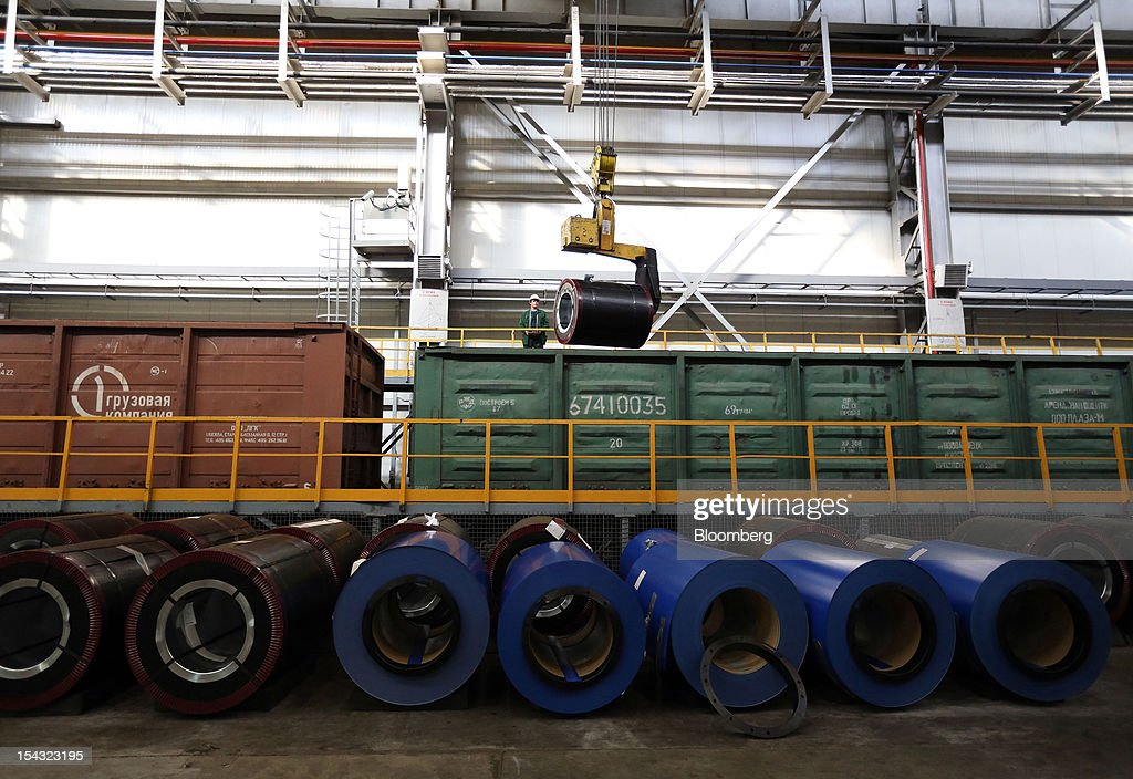 An employee operates a crane to load polymer-coated steel rolls into rail wagons for shipping at the OAO Novolipetsk Steel plant, also known as NLMK, in Lipetsk, Russia, on Wednesday, Oct. 17, 2012. OAO Novolipetsk Steel, controlled by billionaire Vladimir Lisin, became Russia's largest steelmaker by output after boosting production by 24 percent. Photographer: Andrey Rudakov/Bloomberg via Getty Images