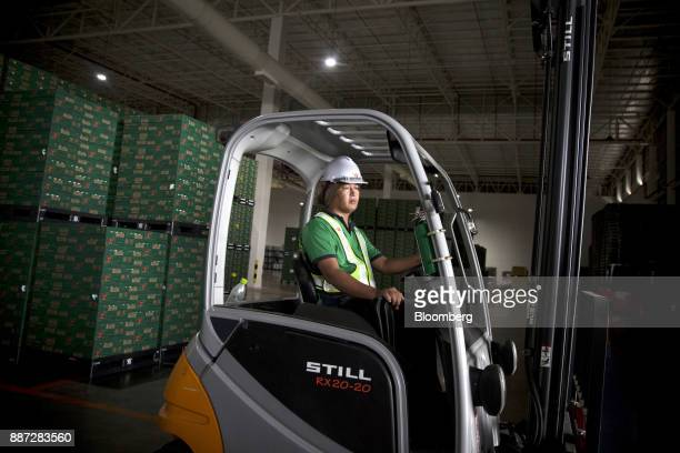 An employee operates a forklift inside the warehouse at the Carabao Group Pcl plant in Chachoengsao Chachoengsao Province Thailand on Saturday Dec 2...