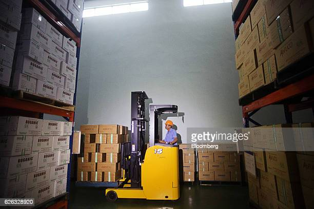 An employee operates a forklift to moves boxes of products through a warehouse at a Traphaco JSC facility in Van Lam district Hung Yen Province...