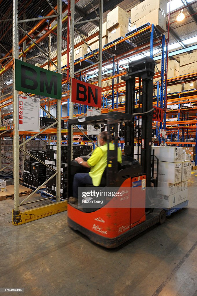 An employee operates a forklift truck as he loads merchandise in the shelving section at the Myer Holdings Ltd. distribution center in Melbourne, Australia, on Tuesday, Sept. 3, 2013. A Bureau of Statistics report released in Sydney on Sept. 4 showed household spending climbed 0.4 percent in the second quarter, adding 0.2 percentage point to gross domestic product growth. Photographer: Carla Gottgens/Bloomberg via Getty Images