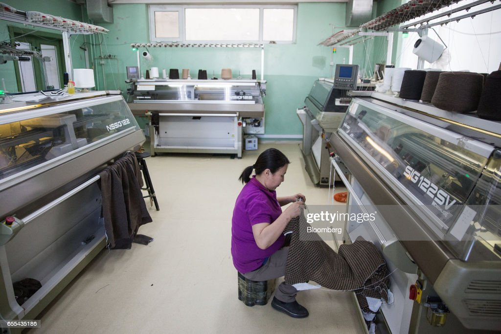 An employee operates a knitting machine at a Bodios Co. garment factory in Ulaanbaatar, Mongolia, on Wednesday, March 15, 2017. Mongolia's gross domestic product is expected to expand eight percent by 2019, and then grown at around five to six percent after that, International Monetary Fund (IMF) Mission Chief for Mongolia, Koshy Mathai, said in an interview last month with Bloomberg Mongolia TV. Photographer: Taylor Weidman/Bloomberg via Getty Images