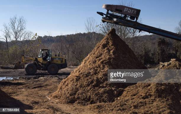 An employee operates a Komatsu Ltd WA250 wheel loader next to a pile of mulch at the Cyblair Sawmill in West Columbia West Virginia US on Friday Nov...