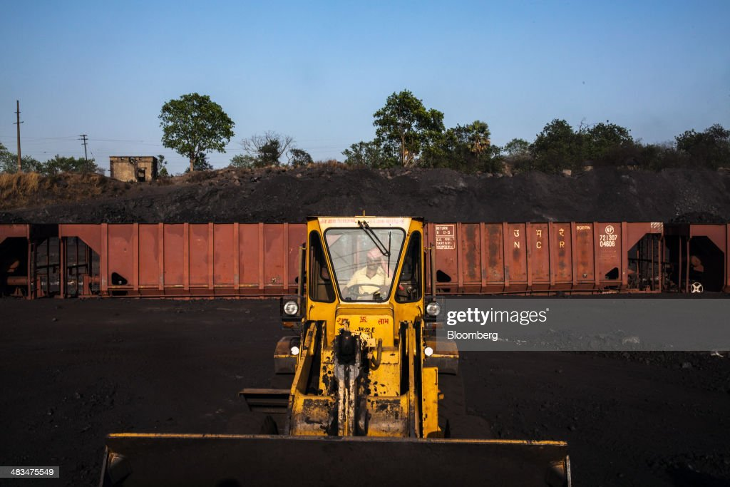 An employee operates a loader at a coal depot, operated by Coal India Ltd. subsidiary Bharat Coking Coal Ltd. (BCCL), in Jharia, Jharkhand, India, on Sunday, April 6, 2014. Coal India, the worlds largest producer, estimates on its website that the nation faces a supply deficit of 350 million tons by 2016-2017, thereby overtaking import demand from China, the worlds biggest coal consumer and producer. Photographer: Sanjit Das/Bloomberg via Getty Images