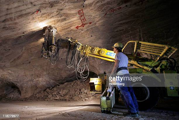 An employee operates a machine to secure ceiling anchors at the KS AG potash mine in Unterbreizbach Germany on Tuesday July 5 2011 KS AG Europe's...