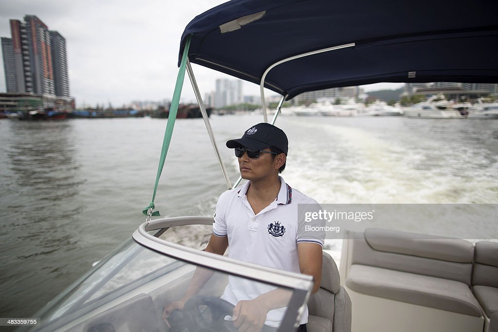 An employee operates a motorboat at the Visun Royal Yacht Club in the Sanya Bay district of Sanya, Hainan Province, China, on Monday, April 7, 2014. The yuan is poised to recover from declines that have made it Asia's worst-performing currency as China seeks to prevent an exodus of capital that would threaten economic growth, according to the most accurate forecasters. Photographer: Brent Lewin/Bloomberg via Getty Images
