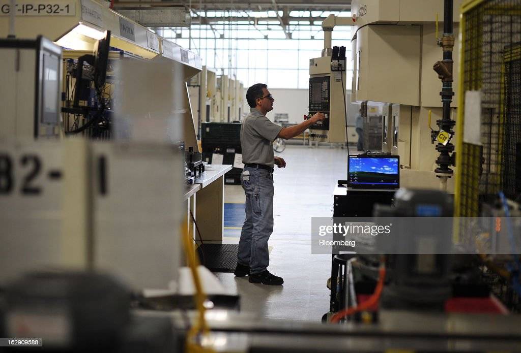 An employee operates an automated milling machine at the Chrysler Group transmission plant in Kokomo, Indiana, U.S., on Thursday, Feb. 28, 2013. Chrysler Group LLC, the automaker majority owned by Fiat SpA, will invest about $374 million and add 1,250 jobs at Indiana factories to boost output of eight-and nine-speed transmissions. Photographer: Daniel Acker/Bloomberg via Getty Images