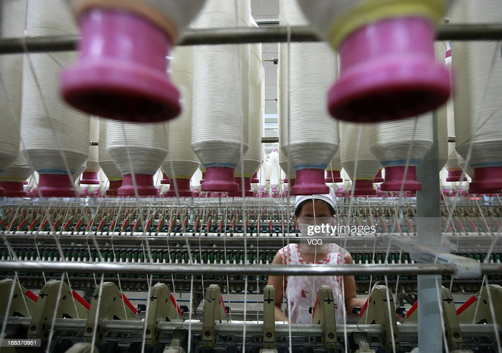 An employee operates machines for making yarn at a textile factory on May 8, 2013 in Jiujiang, China. China's consumer price index (CPI), the main gauge of inflation, rose 2.4 percent year-on-year in April.