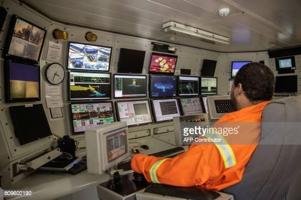 An employee operates the crawler sweeping the seabed on The Diamonds Sea Mining vessel MAFUTA from Debmarine a joint venture between Diamonds Mining...