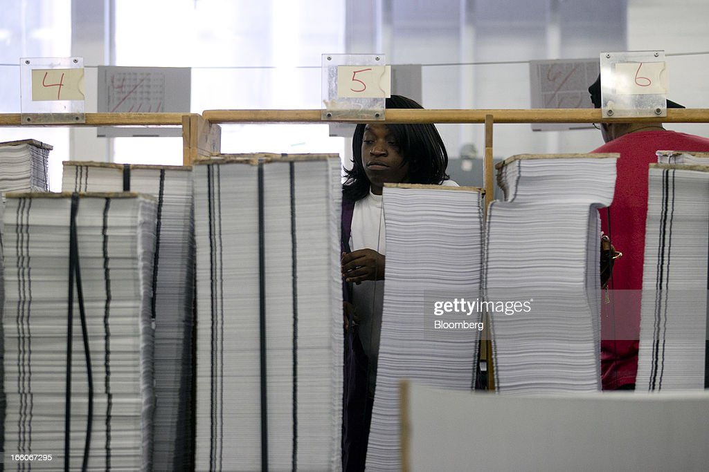 An employee organizes copies of the Fiscal Year 2014 Budget at the U.S. Government Printing Office in Washington, D.C., U.S., on Monday, April 8, 2013. Less than a week after job-creation figures fell short of expectations and underscored the U.S. economy's fragility, President Barack Obama will send Congress a budget that doesn't include the stimulus his allies say is needed and instead embraces cuts in an appeal to Republicans. Photographer: Andrew Harrer/Bloomberg via Getty Images