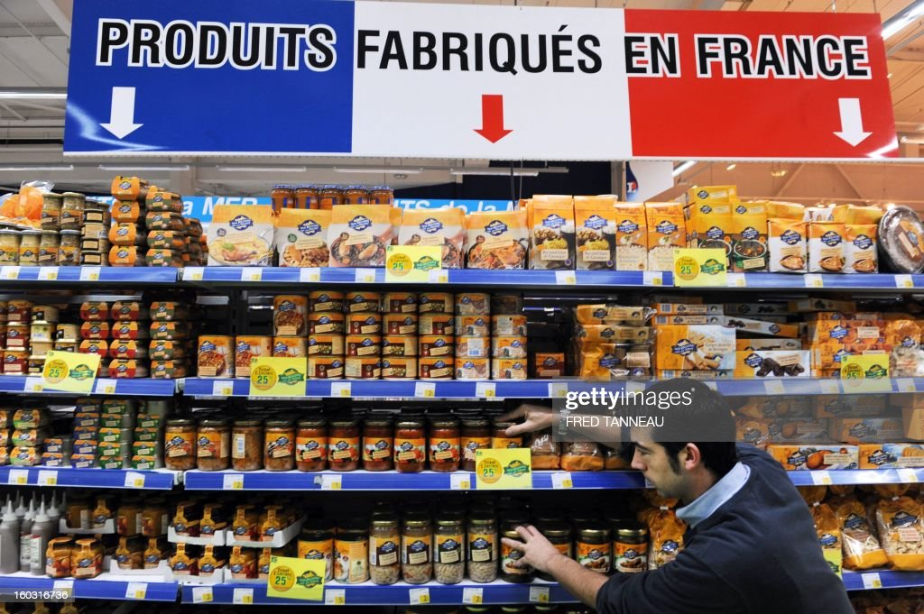An employee organizes goods on shelves with 'Made in France' producst on January 29, 2013 in a Leclerc hypermarket in Lanester, western of France. The distribution group Leclerc test in several of his stores shelves 'made in France' requested by French Industrial Renewal Minister Arnaud Montebourg, and gives a year to 'optimize' the concept, said his boss Michel-Edouard Leclerc.