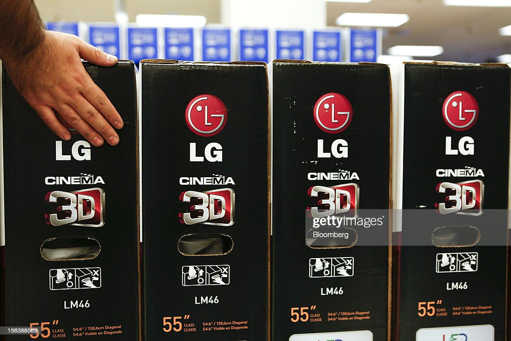 An employee organizes LG Cinema 3D televisions for sale at a Sears store during the Family and Friends evening sale inside the Del Amo shopping mall in Torrance, California, U.S., on Sunday, Nov. 11, 2012. Sears Holdings Corp. is scheduled to announce earnings results on Nov. 15 before the opening of U.S. financial markets. Photographer: Patrick Fallon/Bloomberg via Getty Images