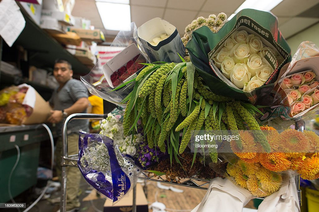 An employee packages orders at George Rallis Inc. wholesale flower shop in New York, U.S., on Monday, Oct. 7, 2013. Wholesale inventories figures, which were scheduled for Oct. 9 by the U.S. Census Bureau, will not be released due to the partial government shutdown. Photographer: Craig Warga/Bloomberg via Getty Images