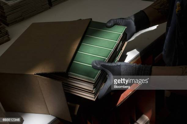 An employee packages tile pieces for shipment at the Heath Ceramics Ltd production facility in San Francisco California US on Friday June 2 2017 The...