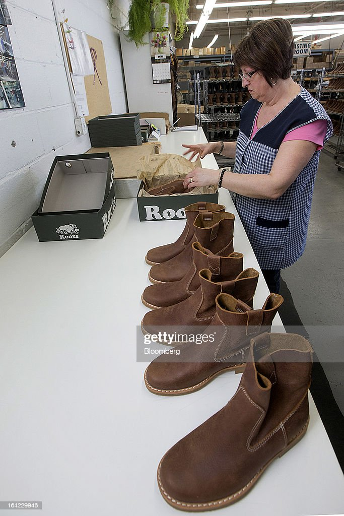 An employee packs finished boots at the Roots Ltd. manufacturing facility in Toronto, Ontario, Canada, on Wednesday, March 20, 2013. Roots Ltd., a Canadian clothing and lifestyle products retailer, manufactures footwear, leather goods, active athletic wear, yoga wear, accessories and home furnishings. Photographer: Norm Betts/Bloomberg via Getty Images