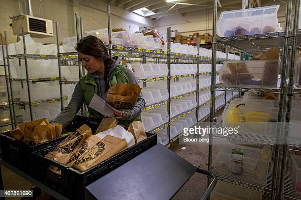 An employee packs food at the Good Eggs distribution center in San Francisco California US on Wednesday Feb 4 2015 Good Eggs is a technology company...