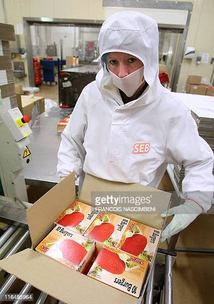 An employee packs on June 16 the frozen ground beef on the production line at the French company SEB in SaintDizier eastern France Six children are...