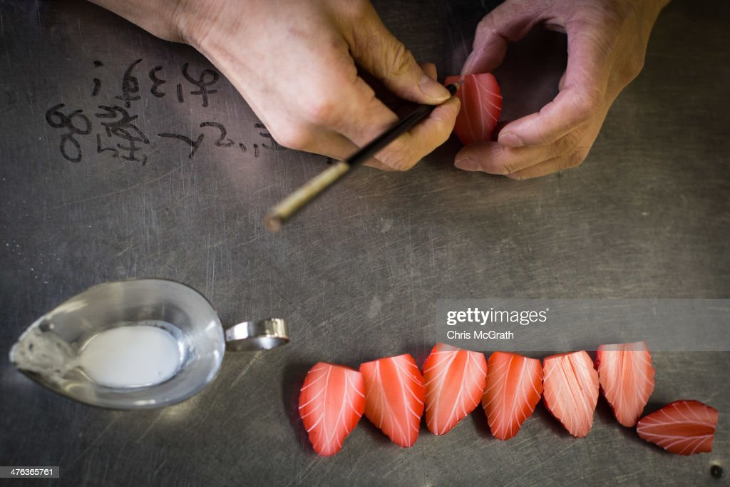 An employee paints a strawberry food sample made of vinyl at the Iwasaki Co., LTD sample food factory on March 3, 2014 in Yokohama, Japan. Sample food products can be seen in the windows of many restaurants throughout Japan. The factory creates precision replica food plates moulded from real food supplied by the client. The Iwasaki Co., LTD facility is one of the largest suppliers in Japan, producing approximately 270,000 sample plates per year to over 20,000 food outlets across Japan and internationally.