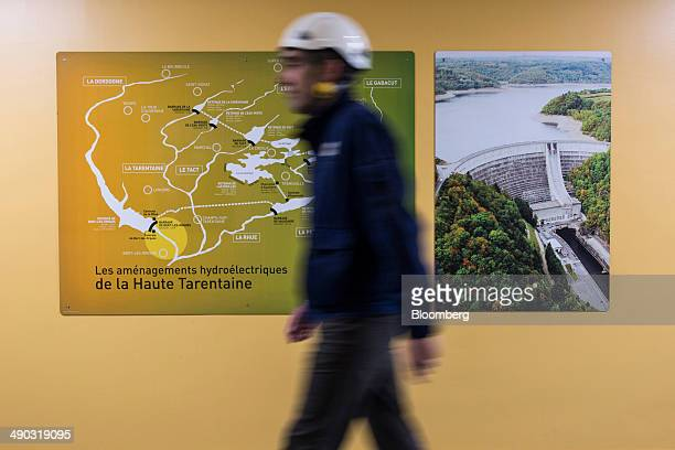 An employee passes a map displaying water sources inside a hydroelectric power plant operated by Electricite de France SA in BortlesOrgues France on...